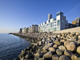 Apartments located next to the water. Boulders works as protection against the waves. Photo